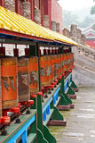 Row of Tibetan prayer-wheels in Chengde, China. Row of Tibetan prayer-wheels at the famous Puning temple in Chengde, china Royalty Free Stock Image