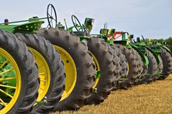 Row of tires of green tractors Stock Photos