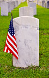 Row of tombstones with american flag. Tombstones on a national cemetery with the american flag Royalty Free Stock Photography