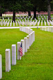 Row of tombstones with american flag Stock Images