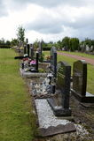 Tombstones at a graveyard. A row of tombstones at a graveyard Stock Images