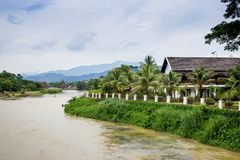 Row of tourist bungalows along Nam Song River in Vang Vieng, Vie. Ntiane Province, Laos. Vang Vieng is a popular destination for adventure tourism in a limestone royalty free stock photography