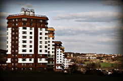 Row of Tower Blocks. Social housing tower blocks progressing down a hill Stock Photo
