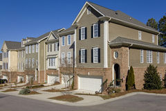 Row of townhomes with garages stock photo