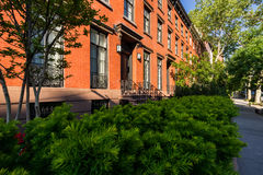 Row of townhouses with brick facades in Summer. Chelsea. Manhattan, New York City Stock Image