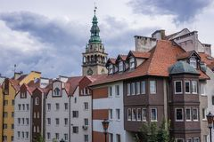 Klodzko in Poland. Row of townhouses in Klodzko town, Poland - Town Hall tower on background Stock Image