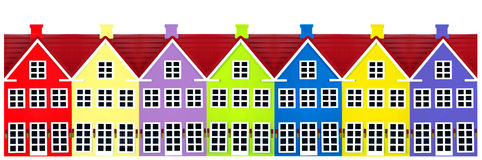Row Of Toy Houses. Row of colored toy houses on a white background Royalty Free Stock Photo