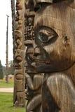 Row of traditional Gitxsan totem poles, village of Gitanyow Stock Photography