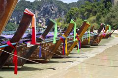 Row of traditional longtail boats in thailand stock photography