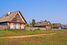Row of traditional wooden houses in a remote village in Russian Royalty Free Stock Photos