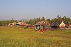 Row of traditional wooden houses in a remote village in Russian Royalty Free Stock Photo