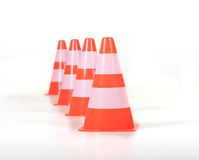 Row of traffic cones / pylons. Four traffic cones in a row behind each other Stock Images