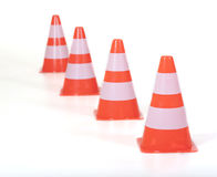Row of traffic cones / pylons. Focus on the front pylon, depth of field Stock Photo