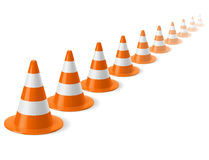 Row of traffic cones. Row of white and orange traffic cones on white background. Safety sign used to prevent accidents during road construction Stock Images