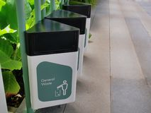Group of Trash Bins with Texts and Icon Label Showing Each Type of Waste. Row of Trash Bins with Texts and Icon Label Showing Each Type of Waste royalty free stock image