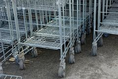 Row of trolleys from a supermarket in the street on the sidewalk Stock Photography