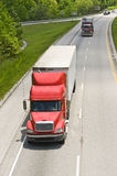 Semi trucks on highway Stock Images