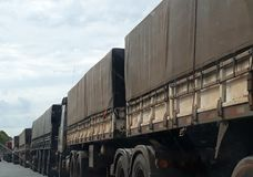 row of trucks with load royalty free stock images
