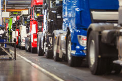 Row of trucks in a production hall Royalty Free Stock Images