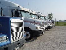 Stop for trucks. A row of trucks during a stopover, travel breaks. A row of trucks during a stopover, travel breaks. Stop for trucks royalty free stock images