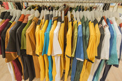 Row of tshirts hanging on a rail Stock Image