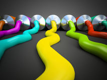 Row of tubes with multicolored paint on grey background Royalty Free Stock Image