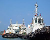 A Row of Tugboats in the Harbor Royalty Free Stock Photos