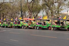 Row of tuk tuk taxi tricycles waiting on street for costumers. Royalty Free Stock Photography