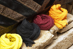 Row of Turbans. Colorful variety of turbans on a sandstone wall Royalty Free Stock Photography