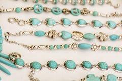 Row of turquoise bracelets on jewelry market Stock Photography