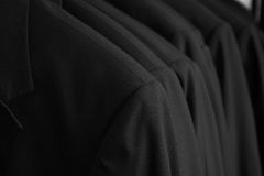 Row of tuxedo dinner jackets Royalty Free Stock Photography