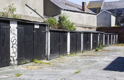 A row of typical lock up rental garages with flat roofs in poor repair in Bangor County Down Northern Ireland royalty free stock images