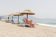 Row of umbrellas and sun beds Stock Photography