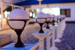 Row of Unlit Globe Lights on Stone Patio Stock Images