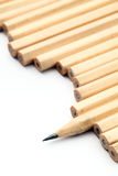 Row of unused pencil with one sharpened Stock Images