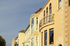 A row of upscale houses with roof and cornice detail Stock Photo