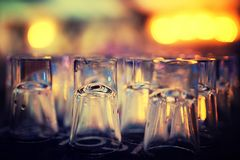 Row of upside down shot glasse Stock Photo
