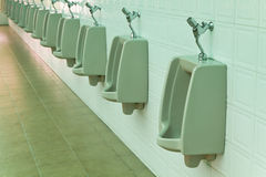 A row of urinals Stock Photo