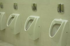 Row of urinals Royalty Free Stock Photography