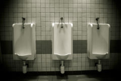 Row of urinals Stock Photos