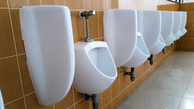 Row of  urinals men Royalty Free Stock Photography