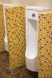 Row of urinals men public toilet. Close up row of urinals men public toilet Stock Image