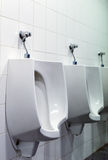 Row of urinals. Royalty Free Stock Photography