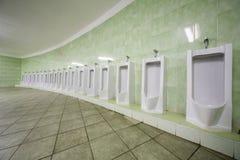 Row of urinals Stock Photos