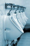 Row of urinals in a public toilet Stock Photos