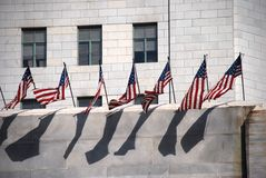 Row of US Flags on Wall Royalty Free Stock Photos