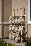 Row of utility meters. Outside an apartment complex Royalty Free Stock Image