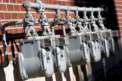 Row of Utility Meters 2. A row of uitility meters (gas/electric) against the side of an old brick apartment complex (shallow focus royalty free stock photos