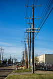 A row of utility power poles Royalty Free Stock Photos