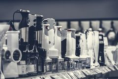 Row of variety blenders in retail store royalty free stock photo